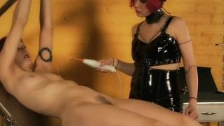 Dominatrix uses her electro wand on her slave